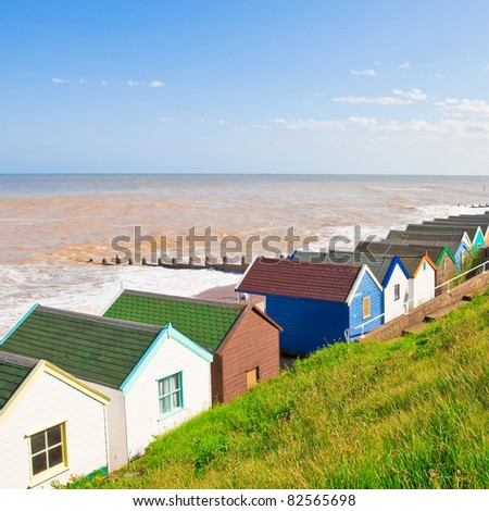 Row of colourful beach huts at Southwold, England - stock photo