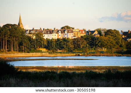 Row of colourful houses overlooking the River Aln in Alnmouth, Northumberland, UK - stock photo