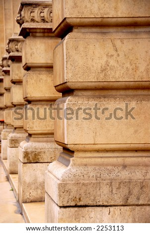 Row of columns in perspective in old historic building - stock photo