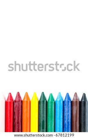 row of crayons isolated on white - stock photo