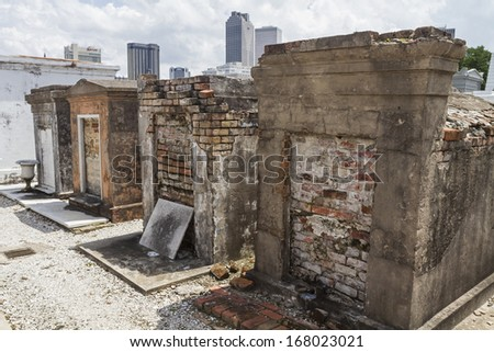 Row of crumbling brick tombs in St. Louis Cemetery in the Treme district of New Orleans - stock photo