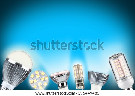 row of different types of glowing light bulbs - stock photo