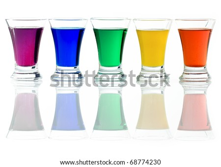 Row of drinks in rainbow colors - stock photo