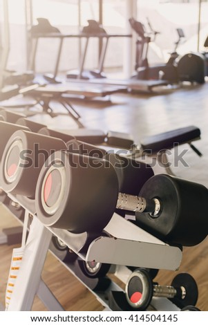 row of dumbbells in sport club, Gym interior - stock photo