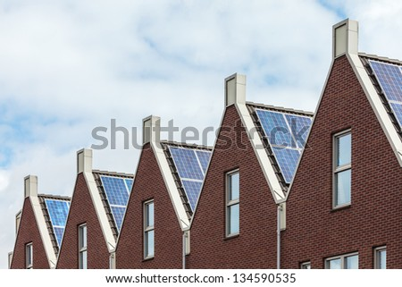 Row of Dutch new houses with solar panels - stock photo