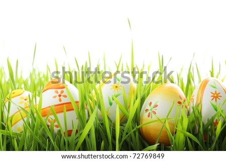 Row of Easter eggs in Fresh Green Grass - stock photo