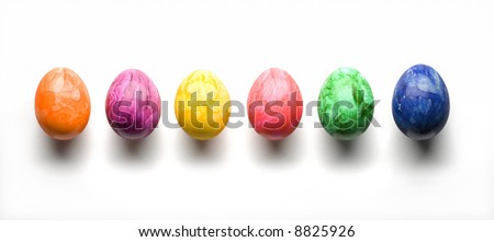 row of easter eggs of various colors isolated on white background with clipping path