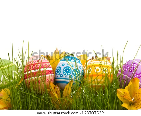 Row of Easter Eggs with Daisy on Fresh Green Grass - stock photo