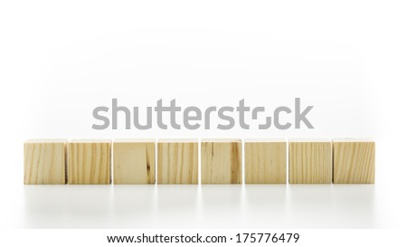 Row of eight blank wooden blocks on a white background with copyspace for your text, letters or numbers