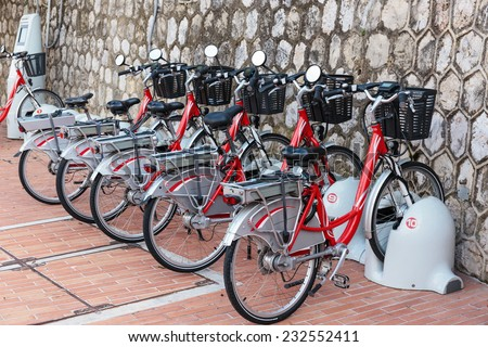 Row of electric bicycles in the parking lot - stock photo