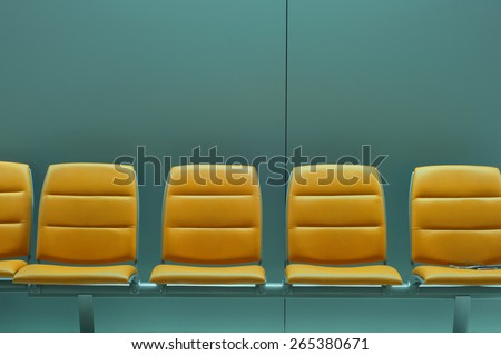 Row of empty chairs at airport waiting area - stock photo