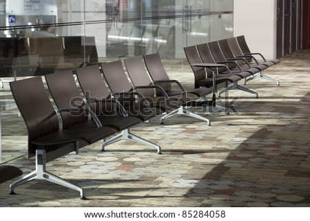 Row of empty chairs at Changi airport, Singapore. - stock photo