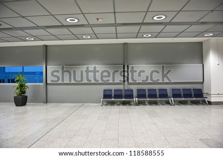 Row of empty chairs in a waiting area of an airport. - stock photo