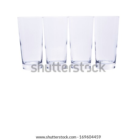 Row of empty glasses over white background