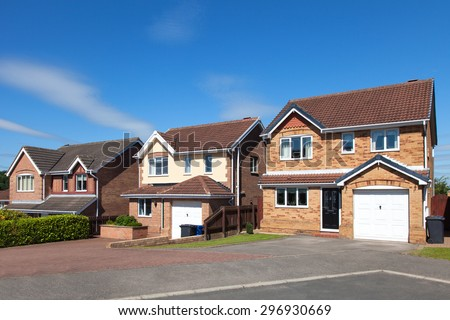 Row of english detached houses - stock photo
