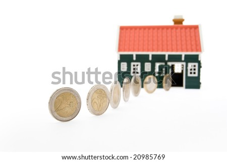 Row of euro coins rolling into a house - on white background