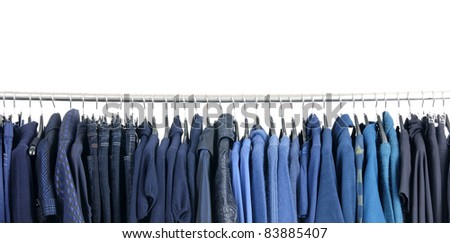 Row of fashion clothes on hangers - stock photo