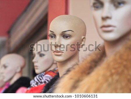 Row of fashionable, expressive window dummy's