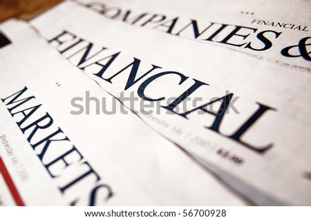 Row of financial newspaper - stock photo