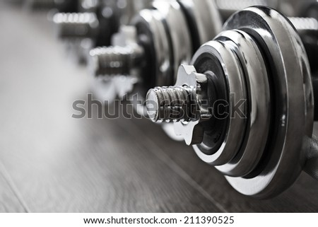 row of fitness dumbbells - stock photo