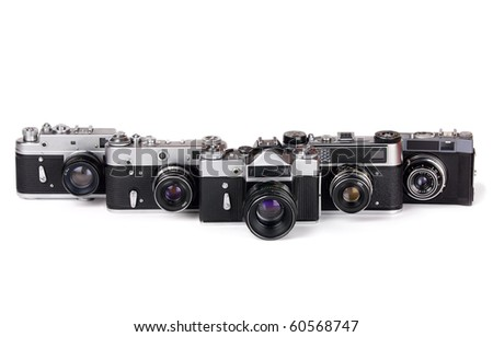 row of five 35mm photo cameras on white background