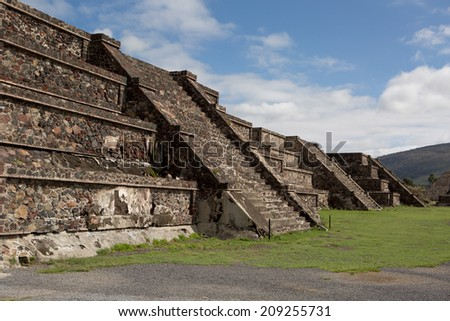 row of flat top Aztec pyramids in Teotihuacan - stock photo
