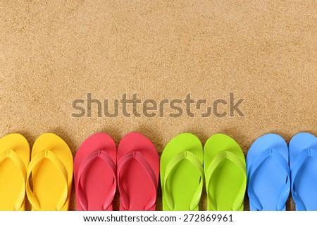 Row of flip flop sandals, summer beach border, copy space. - stock photo