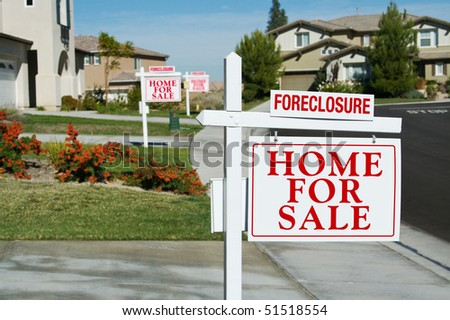 Row of Foreclosure Home For Sale Real Estate Signs in Front of Houses. - stock photo