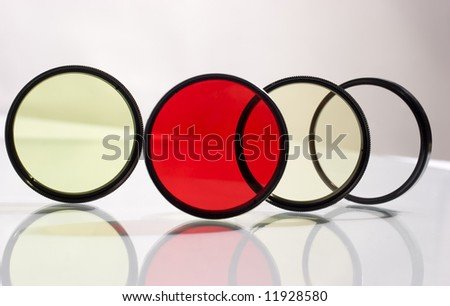 Row of four photo filters with reflection
