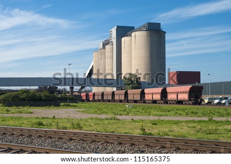 row of freight trains in front of an industrial building in Rotterdam harbor - stock photo