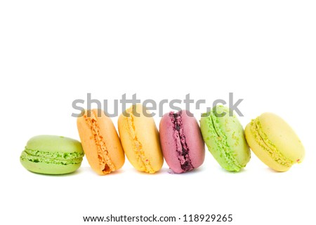 row of french macaroons isolated on white background - stock photo