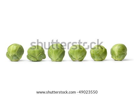 Row of fresh Brussel sprouts  on white background - stock photo