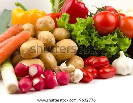 row of fresh vegetables on white - stock photo