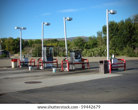 row of gas pumps - stock photo