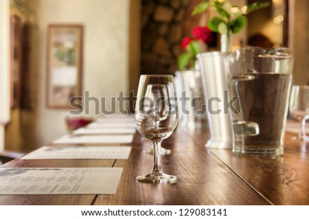 Row of glasses in a restaurant. Shot in South Africa. - stock photo
