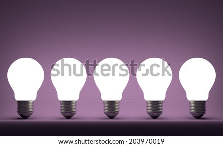 Row of glowing tungsten light bulbs on violet textured background - stock photo
