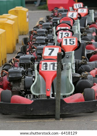 Row of go karts waiting to go out onto the track - stock photo