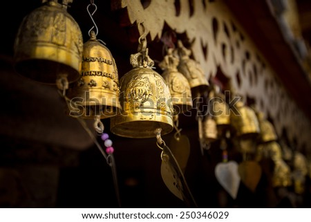Row of golden bells in buddhist temple - stock photo
