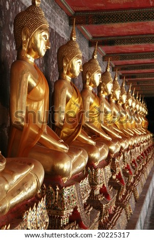 Row of golden Buddha statues in Wat Pho, Bangkok