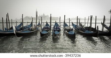 Row of Gondolas in Venice Italy - stock photo
