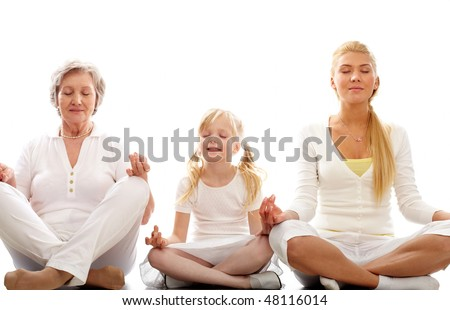 Row of grandmother, mother and child meditating together - stock photo