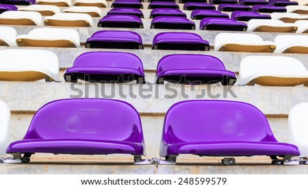 Row of Grandstand chairs in stadium - stock photo