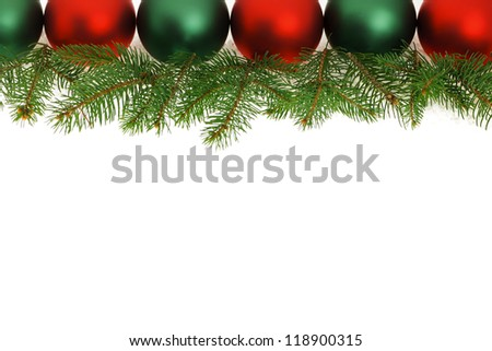 Row of green and red Christmas ornaments with tree branches