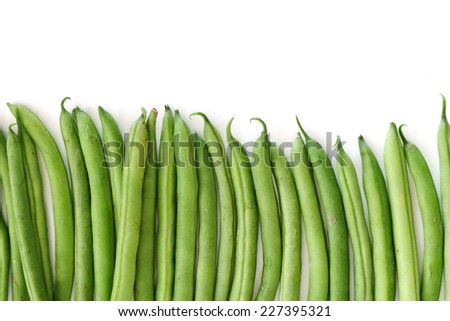 row of green beans isolated on white background - stock photo