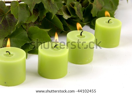 Row of green candle and ivy