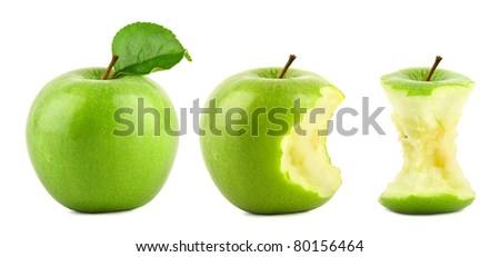 row of green granny smith apples on white background - stock photo