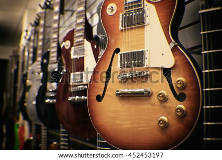 row guitars on display sale hanging stock photo 452453197 shutterstock. Black Bedroom Furniture Sets. Home Design Ideas