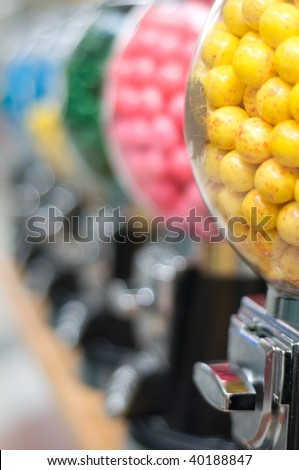 row of gum ball machines with narrow depth of field - stock photo