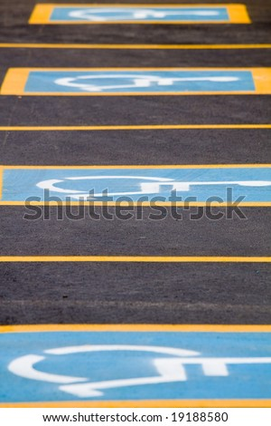 Row of handicapped only parking spaces - vertical - stock photo