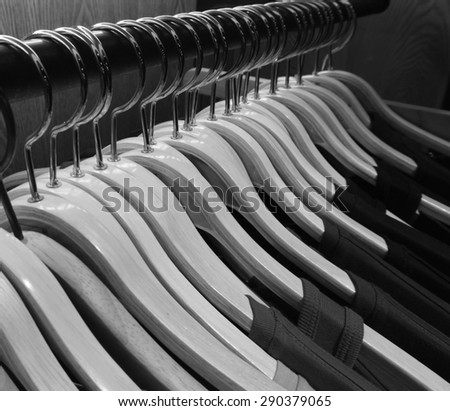 row of hanger with shirt,black and white tone. - stock photo